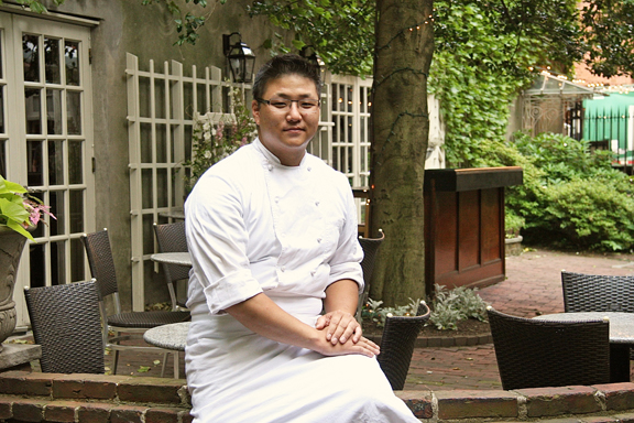 executive chef Kyle Beebe in M Restaurant's courtyard