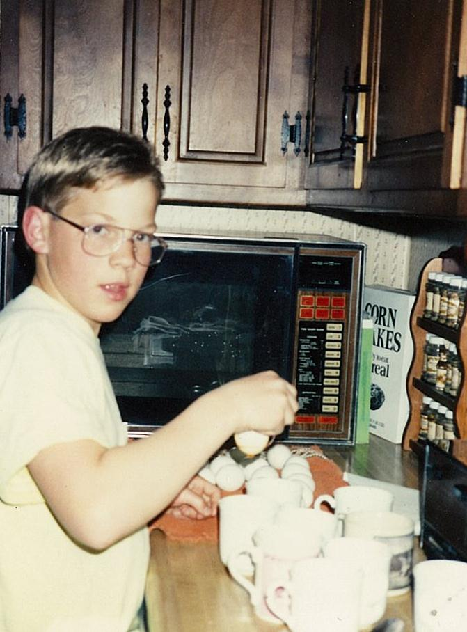Chef Ryan as a child cracking eggs (photo courtesy of Centered Chef)