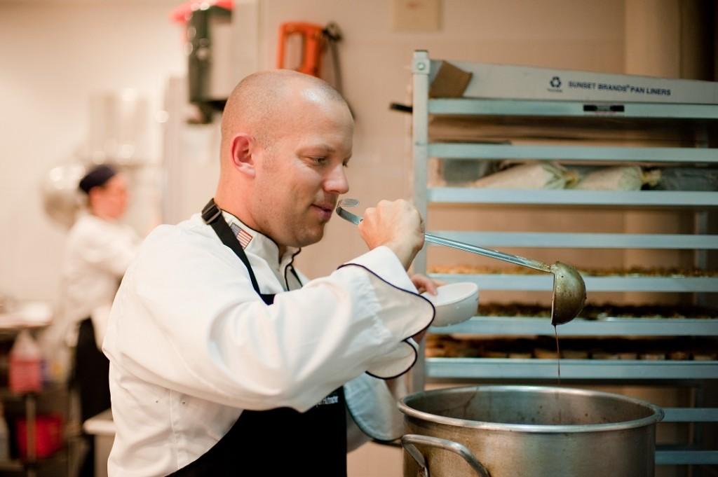 "Chef Ryan ""saucing"" with ladle (photo courtesy of Centered Chef)"