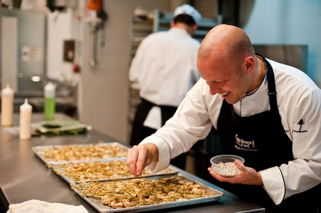 Chef Ryan seasoning food  (photo courtesy of Centered Chef)