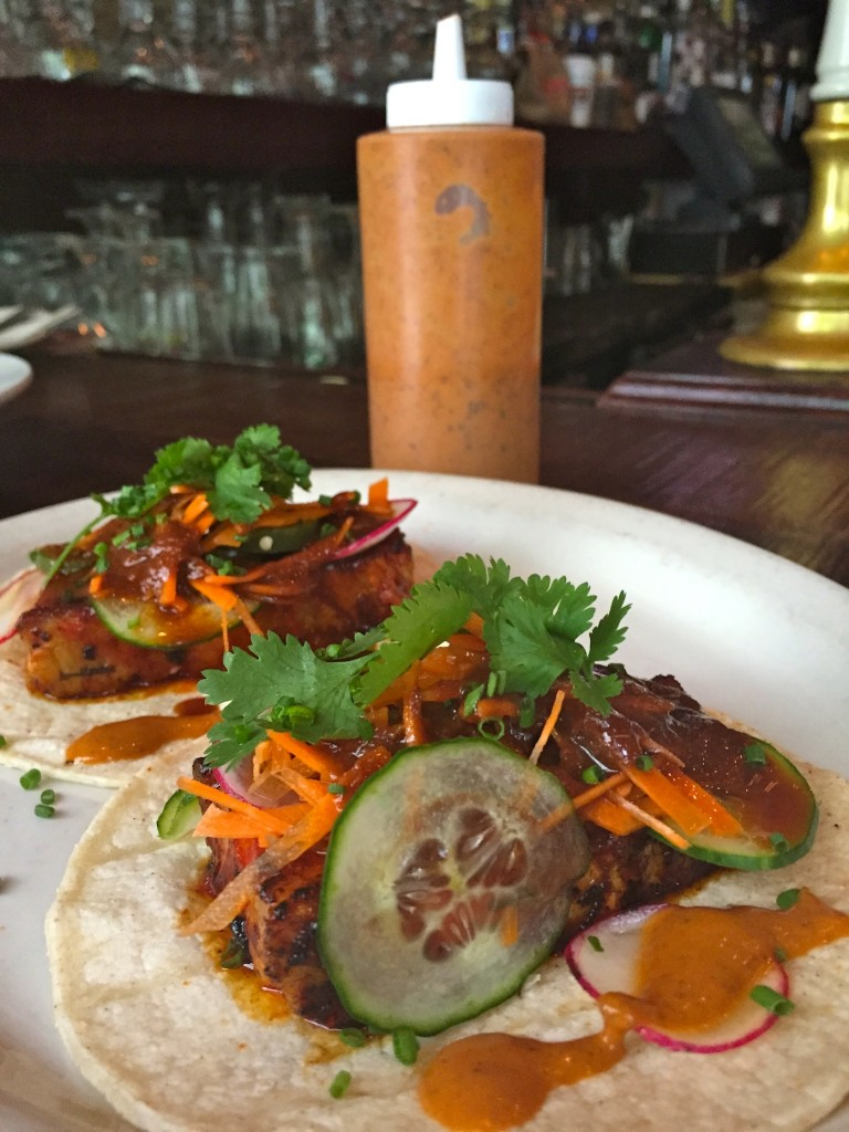 pork belly Bahn Mi tacos with homemade hot sauce at Jose Pistola's (photo by Lee Porter)